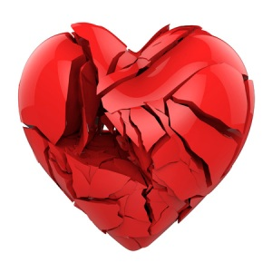 52854194 - broken red heart isolated on white background